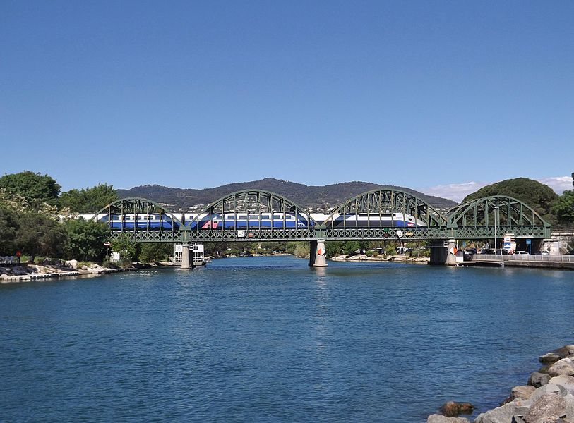 Sight of the railway bridge crossing the river Siagne in Mandelieu-la-Napoule, near Cannes, in Alpes-Maritimes, France.