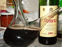 porrón with kalimotxo and the used bottle of 1983 vintage wine.