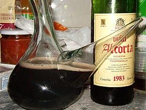Kalimotxo - A porrón with kalimotxo and the used bottle of 1983 vintage wine.