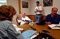 President George W. Bush reads over paperwork.jpg