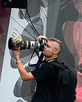Press photographer with mammoth lens at III Meeting of Fans of the TV series 'M jak miłość' in Gdynia 2009
