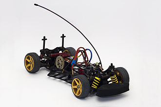 Radio-controlled model - The 'Shumacher S.S.T.2000' RC Car. Shown here without the body kit or battery pack installed to allow for a clearer view of a hobby grade car.