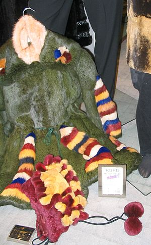 Rabbit hair - A child's multicoloured rabbit coat and cap – rabbit became popular because it could be dyed to create different effects or sheared to imitate other animal furs