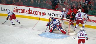Henrik Lundqvist - Lundqvist during a game against the Calgary Flames in the 2007–08 season. During that season, Lundqvist signed a six-year extension with the New York Rangers.