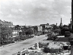 A view from the Custom House on Dalhousie Street (Maha Bandula Garden Street) showing the extent of the damage during World War II.