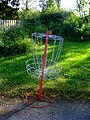 Red disc golf basket.jpg