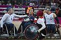Retired U.S. Sailor William Groulx, center left, the U.S. wheelchair rugby team captain, holds the ball as members of the Great Britain team try to recover it during a match at the Paralympic Games in London 120905-F-FD742-1528.jpg