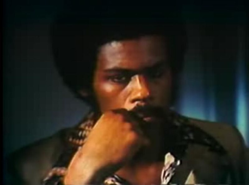 """File:RichardLawsonBlackFist.JPG Description Richard Lawson in Black Fist (1974). Screenshot. Date 13 January 2008 (screenshot taken) Source """"Black Fist"""" (1974) Author Timothy Galfas Permission (Reusing this file)   Public Domain; published before 1978 without a copyright notice. Black Fist is in public domain [1] [2] [3]"""