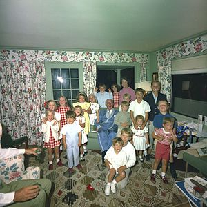 Rose Kennedy - Rose Kennedy (standing, rear) with her husband Joseph P. Kennedy Sr. and grandchildren, 1963. John Jr. can be seen in the foreground.