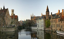A canal in Bruges with the famous Belfry in the background