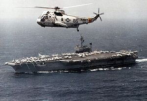 SH-3H HS-8 above USS Constellation (CV-64) 1987.jpg