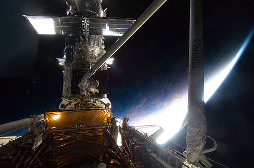 Astronaut working on Hubble during Service Mission 4, which included the installation of WFC3.