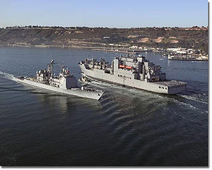 USNS Sacagawea passing USS Mobile Bay (CG-53) in the entrance to San Diego Bay