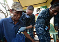 Sailors provide assistance to typhoon victims. (10968560073).jpg