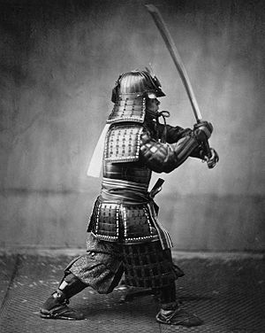Armoured samurai with sword and dagger Françai...