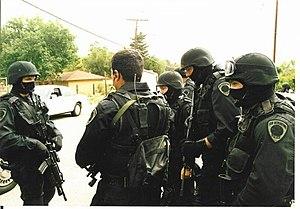 English: San Bernardino police SWAT team confe...