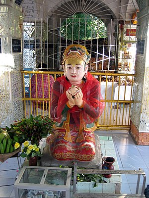 Mandalay Hill - Sanda Muhki, the ogress, offering her own breasts to the Buddha