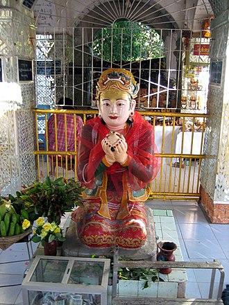 Mandalay Hill - Sanda Muhki, the ogress, offering her own breasts to the Buddha