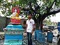 Sandesh Hiwale with the Buddhas at Maharashtra, India..jpg