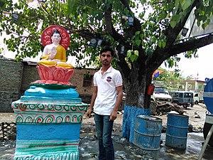 Sandesh Hiwale with the Buddhas at Maharashtra, India..jpg