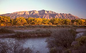 Sandia Mountains - The Sandia Mountains and Rio Grande at sunset, looking southeast from Bernalillo