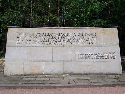 "A memorial at cemetery Heidefriedhof in Dresden. It reads: ""Wieviele starben? Wer kennt die Zahl? An deinen Wunden sieht man die Qual der Namenlosen, die hier verbrannt, im Hollenfeuer aus Menschenhand."" (""How many died? Who knows the count? In your wounds one sees the agony of the nameless, who in here were conflagrated, in the hellfire made by hands of man."") Sandsteinmauerheidefriedhof.jpg"