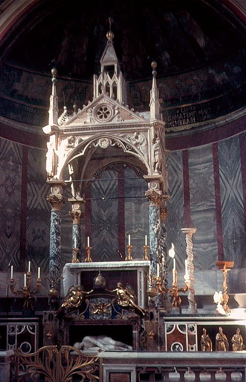 Altar of Santa Cecilia in Trastevere, as arranged in 1700. It is one of many churches in Rome whose altar, placed at the western end of the church, was positioned so that the priest necessarily faced east, and so towards the people, when celebrating Mass. The first Roman churches all had the entrance to the east. Santa Cecilia.jpg