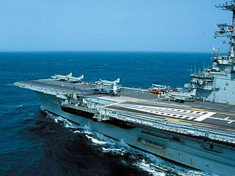 Brazilian Naval Aviation - View of the forward flight deck of the Brazilian aircraft carrier São Paulo (A12), in 2003. Four McDonnell Douglas AF-1 (A-4) Skyhawk fighters and an Argentine Navy Grumman S-2T Tracker are visible.
