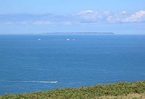 Pierres de Lecq - The Pierres de Lecq (or Paternosters) at high tide seen from Jersey looking towards Sark. The three rocks visible are La Vouêtaîthe, La Grôsse, et L'Êtaîthe