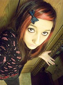 a girl with pinkdyed hair wearing clothings derived from