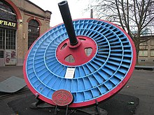 Blue disc-shaped turbine wheel with three blade rings.