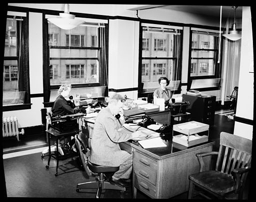 Seattle City Light employees in office, 1954