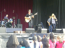 Mendler performing with her then-boyfriend, Shane Harper, in 2011