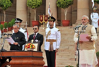 Premiership of Narendra Modi - Modi (far right) being sworn in as Prime Minister, in the presence of President Pranab Mukherjee (far left), 2014.