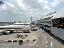 Singapore Airlines aircraft parked at Terminal 2 of Singapore Changi Airport.jpg