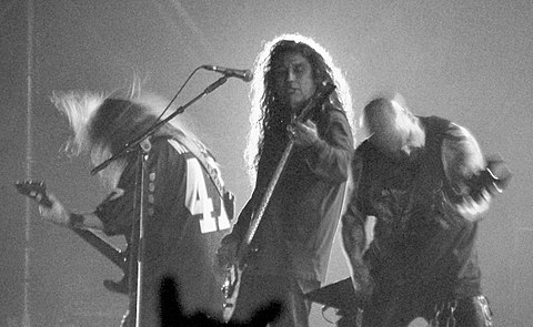Slayer's Jeff Hanneman, Tom Araya and Kerry King at the 2007 Hellfest. Although Slayer were not formed in the Bay Area, the band had gotten an early headstart in the Bay Area thrash metal scene, and are often associated (along with Megadeth ) as being a part of it. SlayerliveB&W.jpg