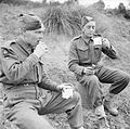 Soldiers from the 78th Division enjoying tea and cakes served by a Salvation Army van in the forward area, Italy, 28 November 1943. NA9413.jpg