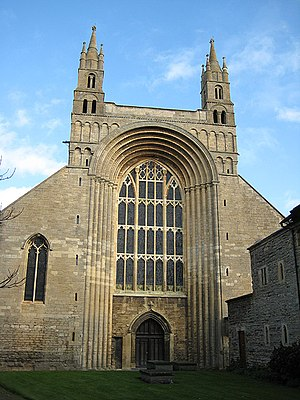 Tewkesbury Abbey - The tall Norman arch of the facade is unique in England