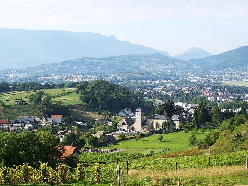 Sight on the French commune of St-Jeoire Prieuré and its church, from the vineyards of the commune. At the background can also be seen Challes les Eaux and la Ravoire, close to Chambéry in Savoie.