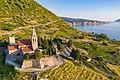 St. Nicholas Church with a view to the Adriatic Sea, Komiza, Croatia (48608680106).jpg