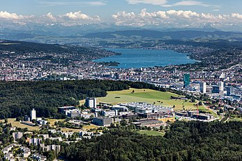 Aerial picture of the Hönggerberg campus. The city of Zurich and the Alps can be seen behind.
