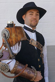 https://upload.wikimedia.org/wikipedia/commons/thumb/7/7c/Steampunk_outfit_at_Maker_fair_in_Greenbelt%2C_MD_013.JPG/220px-Steampunk_outfit_at_Maker_fair_in_Greenbelt%2C_MD_013.JPG