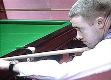 Stephen Hendry playing a shot