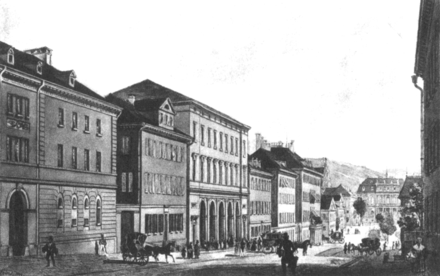 The third building from the left in the picture shows the facade, with the entrance area under the arcades, the first Stuttgart central station, after a plan by the architect Karl Etzel  Karl Etzel (about 1850)
