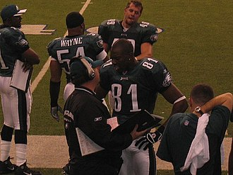 Terrell Owens - Owens (81) with the Eagles talking to a coach.