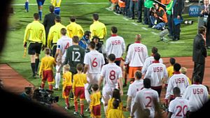 Ledley King - King (wearing No.20) enters the field with his England comrades before the 2010 FIFA World Cup match against the United States.