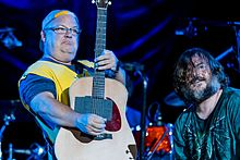Tenacious D playing guitars onstage