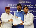 """Thaawar Chand Gehlot distributing the prize to the winner of the """"Babu Jagjivan Ram All India Essay Competition 2016"""", at a function, in New Delhi.jpg"""