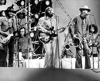 Carl Wilson - Carl (center) performing with the Beach Boys at Central Park, in 1971