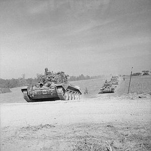 6th Guards Tank Brigade (United Kingdom) - Cromwell tanks of the 2nd (Armoured Reconnaissance) Battalion, Welsh Guards, moving up towards Escoville during Operation 'Goodwood', 18 July 1944.